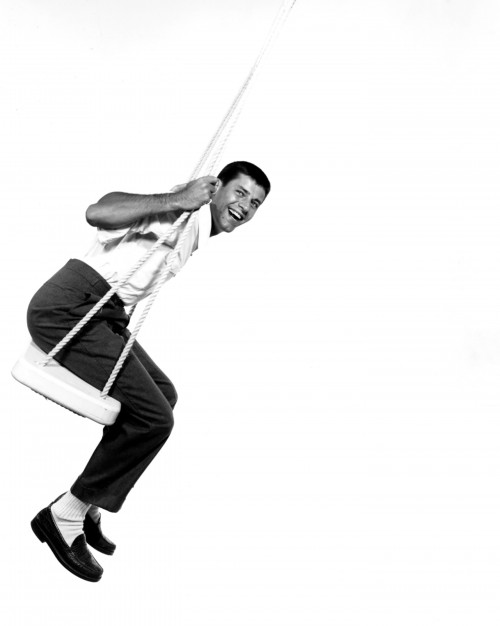 Jerry Lewis Smiling on Swing