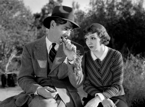 Claudette Colbert and Clark Gable Sitting on Bench